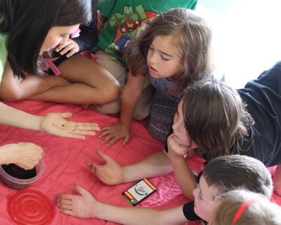 These day campers patiently wait for their turn to hold an isopod (pillbug).