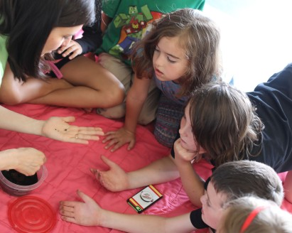 Campers from the Cross Conservation Area are fascinated with isopods and can't wait for a turn to hold one.